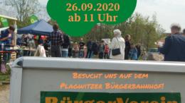 Aufsteller des Leutzscher Bürgerverein mit Menschen im Hintergrund.